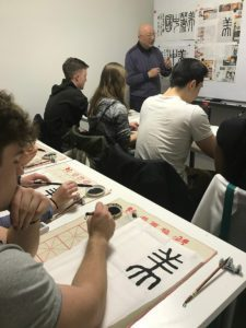 Students learning calligraphy in Shanghai.